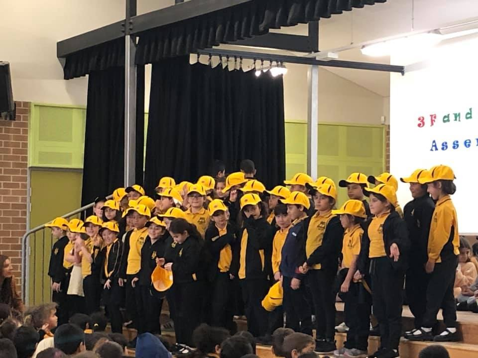 Book Bees receiving their hats.